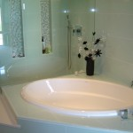 Tub with walk-in shower behind